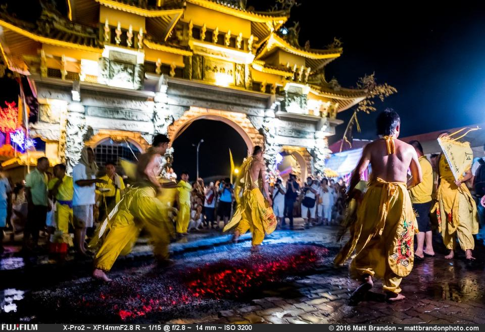 Then without any warning, the group of mediums, the same ones from the oil ceremony and the spear piercing all start walking rapidly across the live coals.