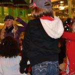 Daughter dancing before the parade