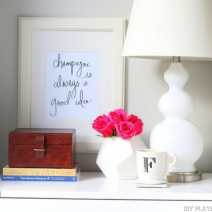09-nightstand-styling-flowers-coffee-lamp