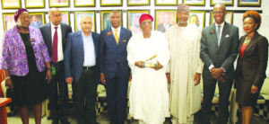 (L-R) Tinu Awe, General Counsel & Head Regulation, Nigerian Stock Exchange (NSE); Haruna Jalo-Waziri, Executive Director, Capital Markets Division, NSE; Sheik Abdul Moshen Rahman Al-Thunayan, Chairman, Medview Airline Plc; Oscar Onyema, CEO, NSE; Muneer Bankole, Managing Director/CEO, Medview Airline Plc; Minister of State for Aviation, Senator Hadi Sirika; Ade Bajomo, Executive Director, Market Operations and Technology, NSE and Pai Gamde, Acting Head, Corporate Services Division, NSE at Facts Behind the Listing of Medview Airline Plc