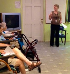 Extension of You Home Care speaker presenting to group.