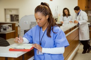 Nurse with discharge orders at nurse's station for care after hospital discharge, including care after surgery or injury.