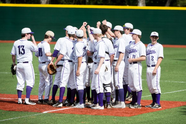 Baseball team comes in for a huddle before the game against Bishop Lynch.