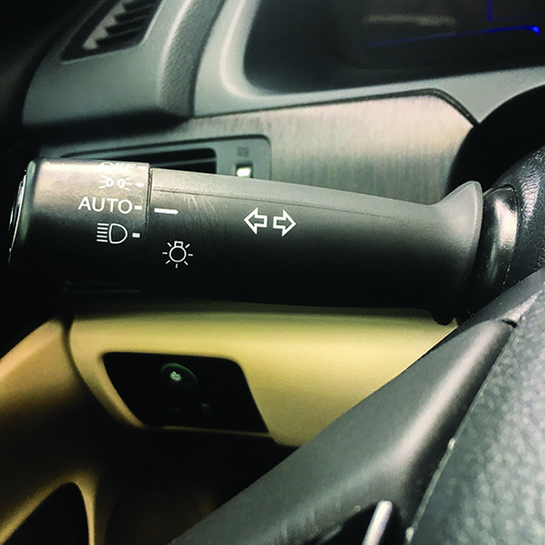 This lever (located to the left of the steering wheel) controls the turn signals on a car. Gently push the lever up to indicate a right turn, or push down to indicate a left turn.