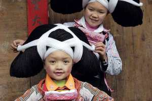 LONG HORN MIAO GIRLS IN TRADITIONAL HEADPIECES