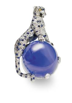 Panther brooch, Cartier Paris, 1949 Platinum, white gold, single-cut diamonds, two pear-shaped yellow diamonds (eyes), one 152.35 carat Kashmir sapphire cabochon, sapphire cabochons (spots)