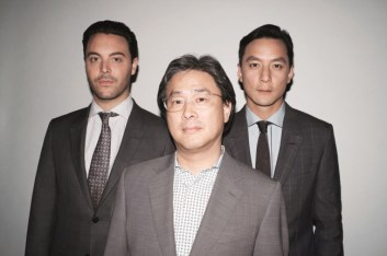 Director Park Chan-wook (center) poses with actors Jack Hudson (left) and Daniel Wu
