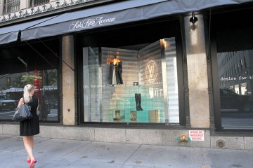 A Louis Vuitton window display at Saks Fifth Avenue