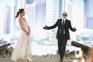 Karl Lagerfeld acknowledges applause following the Chanel Haute-Couture Fall/Winter show 2013-2014