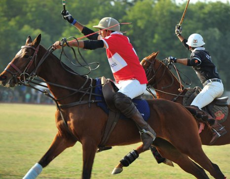 A player from the EFG team battles a rider from the victorious India Army 61st Cavalary side