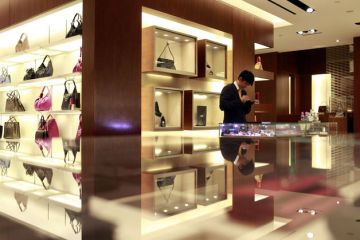 An employee works at a Salvatore Ferragamo SpA store in Shanghai