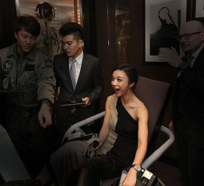 Actress Tang Wei samples the jet fighter simulator at IWC's flagship store in Beijing