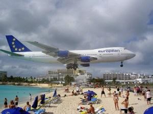 low flying plane beach