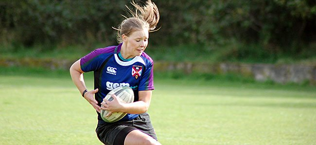 Claire McLaughlin adds experience to a young Queen's back line.