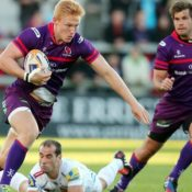 The colour clash of purple and ginger make Rory Scholes almost impossible to tackle!