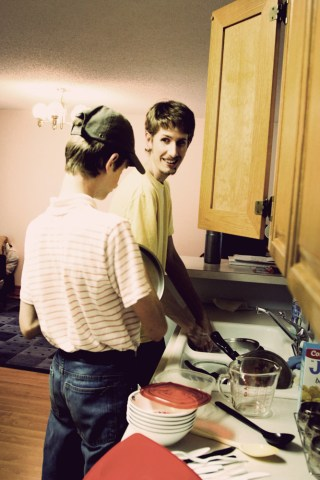 Ben and Sam doing dishes.