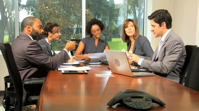 woman chairing a boardroom meeting