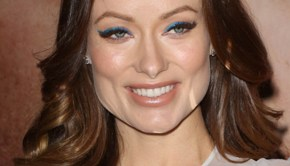 Pregnant Olivia Wilde in blue dress at Her premiere