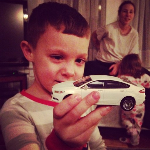 Mason with the toy Ford Fusion