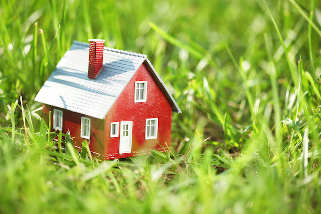 simple red house in grass