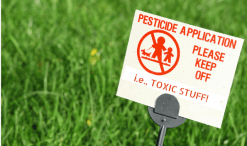 lawn with pesticides sign: toxic to our health
