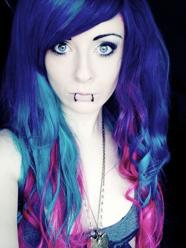 Long hair dyed in blue shades and pink color