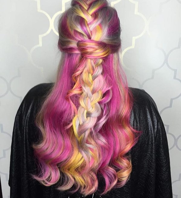 Racy half updo with a braid in the middle