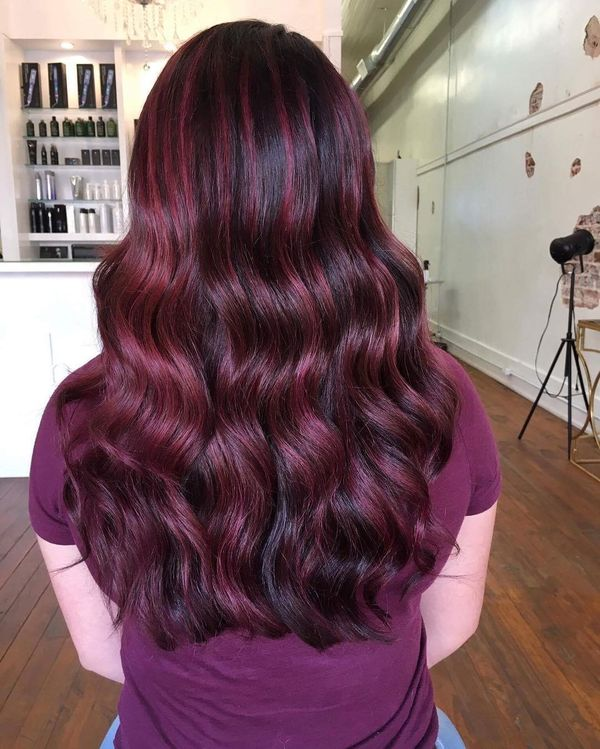 Curls in burgundy and maroon tint