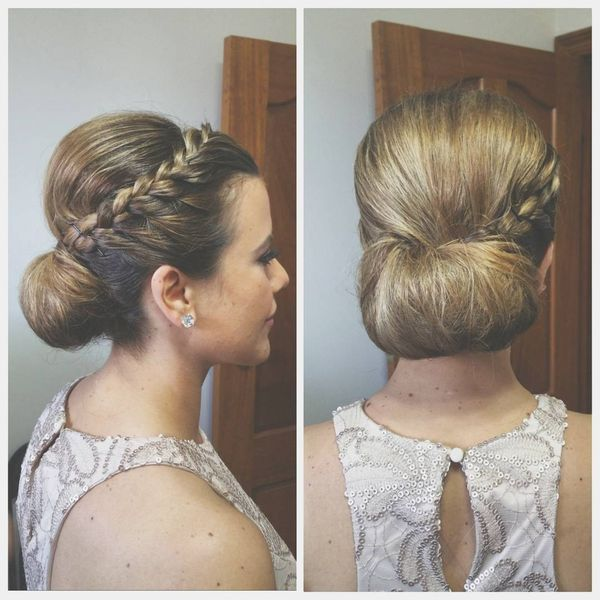 Wedding updo with a side braid and bun