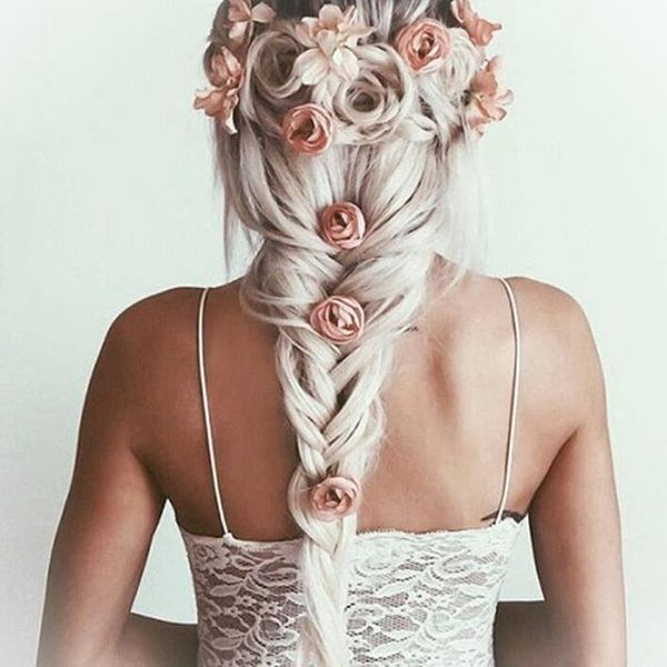 Fishtail braid with half up rosette decorations