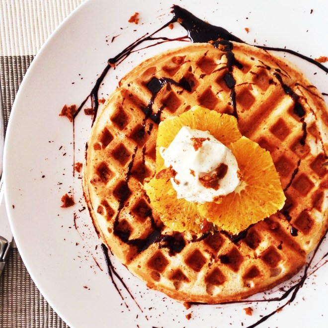 Vanilla waffle with orange, shaved coconut sugar, organic plain youghurt, chocolate syrup.