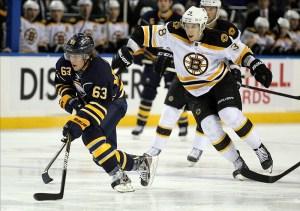 Jordan Caron of the Boston Bruins chasing Tyler Ennis (Timothy T. Ludwig-US PRESSWIRE)