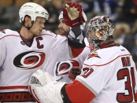 Cam Ward and Eric Staal (Tom Szczerbowski-US PRESSWIRE)