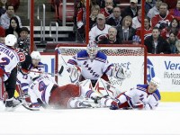Henrik Lundqvist's ability to perform in pressure-packed situations would undoubtedly help the goalie in a rivalry playoff series. (James Guillory-USPRESSWIRE)