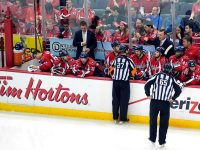 Referee Eric Furlatt addresses the Capitals' bench (Flickr/Clydeorama)