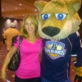 Becky with the Oklahoma City Barons mascot Derrick
