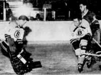 Bruins Eddie Johnston stopped this one while Tom Johnson and Ralph Backstrom (6) look on.