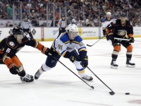 Oct 19, 2014; Anaheim, CA, USA; St. Louis Blues right wing Vladimir Tarasenko (91) reaches for the puck against Anaheim Ducks defenseman Ben Lovejoy (6) during the second period at Honda Center. (Richard Mackson-USA TODAY Sports)