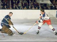 Jean Ratelle tries on Johnny Bower