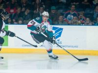 (Marissa Baecker/www.shootthebreeze.ca) An Edmonton Oilers fan looks on as Leon Draisaitl drives wide around Josh Thrower of the Vancouver Giants during his Kelowna Rockets debut, a 4-2 win at Prospera Place on Jan. 7.
