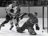 Bobby Hull tests Montreal goalie Gump Worsley