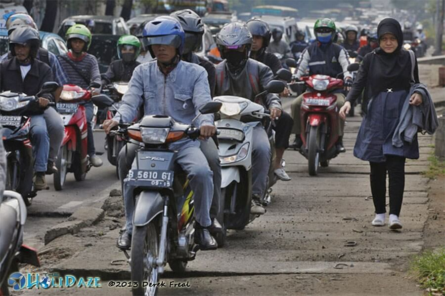 Indonesia by motorcycle. Get used to traffic.