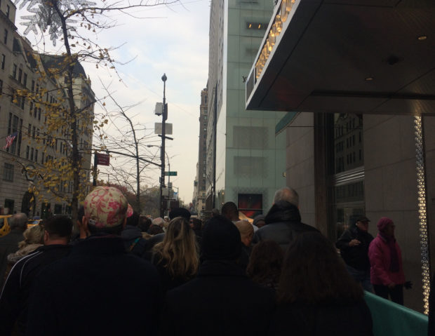 Shoppers on Fifth Avenue face long waits to cross the street. (The Ink/Courtenay Brown)