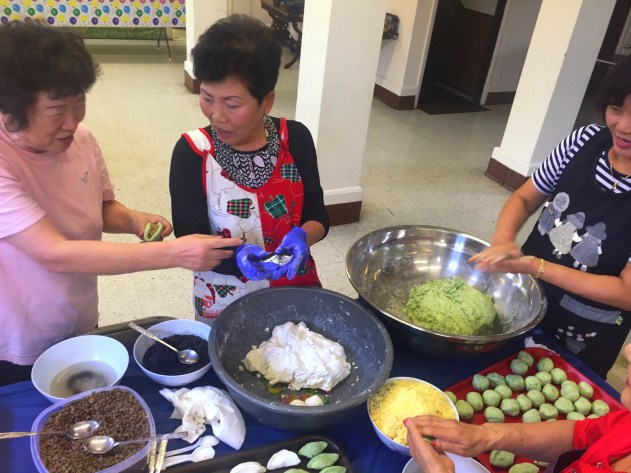 With the Korean national holiday just around the corner, gye members tell one another childhood stories as they gather around a table making rice cakes.