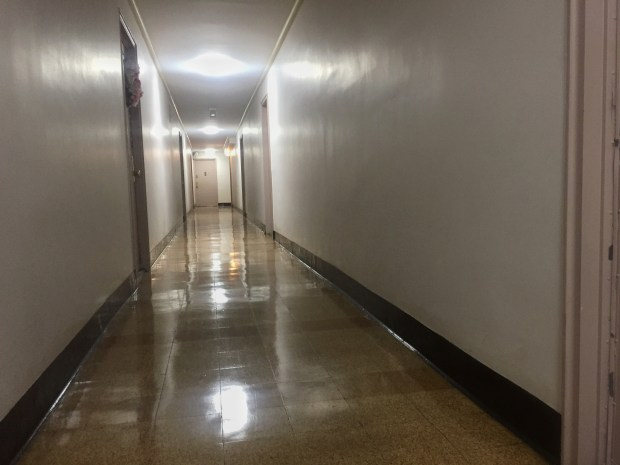 The 11th floor hallway of the Berkeley Towers apartment building in Woodside, Queens. Jose Franqui, 36, the building's maintenance worker who did not testify during the trial, said that the last time he saw Raymond Epps was as he exited the stairwell at the end of the hallway in October 2011. (Nicole Einbinder/The Ink)
