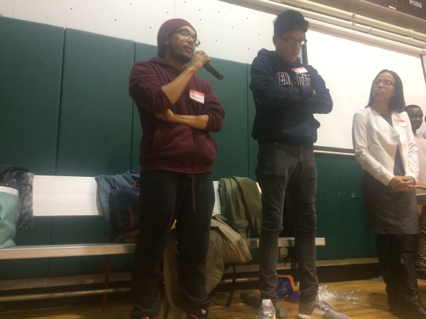 Shawn Gonzalez (left) speaks about the stop-question-and-frisk policy to nearly 100 other students.