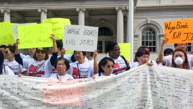 Chinese immigrant nail salon owners protested against the wage bond mandate at City Hall. (Qingqing Hilary He / The Ink)