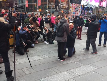 Robert Hulme bent down as he asked Lily Lloyd for her hand in marriage in a pre-planned, but surprise to her, proposal Times Square. (The Ink/Kirsten Watson)