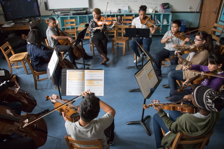 Andrea Maire and her orchestra practice three days a week. (Timmy H.M. Shen / The Ink)