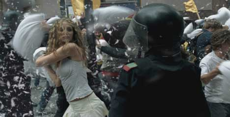 Protester and riot police pillow fight in Absolut TV ad